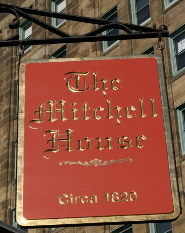Mitchell House V-carved and gilded text. Finished with a tradition rabbet edge profile. 2' x 4'