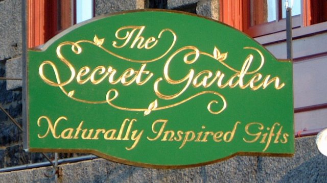 The Secret Garden 2' x 3' v-carved and gilded cedar sign.