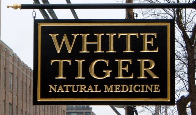 White Tiger 2' x 3' v carved and gilded text. Wrapped with angel aluminum and installed from a custom  bracket.