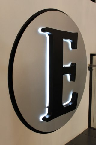 Halo lit text Router cut PVC with punched out text. Back lit with LED lights.