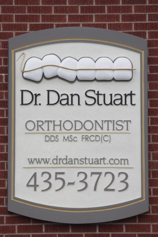 Dr. Dan Stuart Sandblasted HDU with sculpturally carved HDU additions. Painted with custom mixed paints. Installed with angle aluminum painted to match sign.