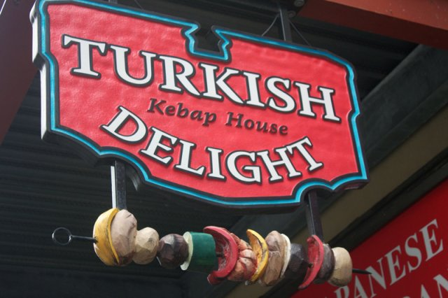 Turkish Delight Sandblasted sign panel with hanging custom metal skewer. HDU sculpturally carved kebap.
