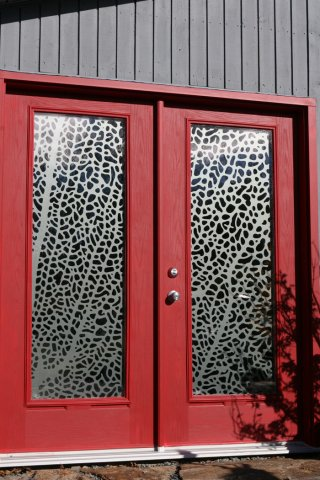 Donna Hiebert  Etched cast vinyl cut in the pattern of a coral reef and installed on exterior glass doors.