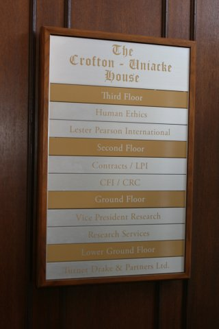 The Crofton House directory Oak frame anodized aluminum faceplates with vinyl text.